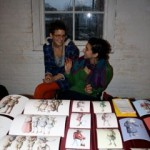 Founder Ani Katz sells artwork with volunteer.