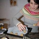 Volunteer helps with the bake sale.